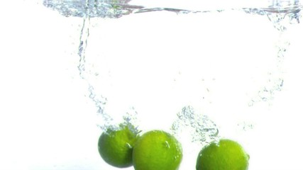 Lime falling into water in super slow motion
