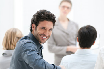Smiling man at meeting