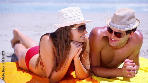 Couple lying on towels