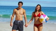 Smiling couple standing upright