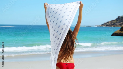Beautiful woman holding a sarong