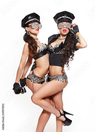 two sexy semi nude police women with long curly hair
