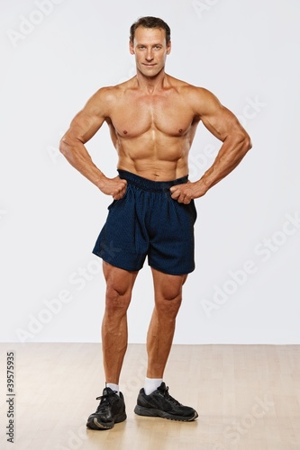 Handsome muscular man standing.