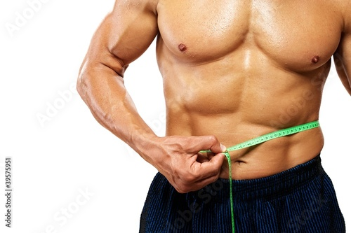 Man measuring his waistline.