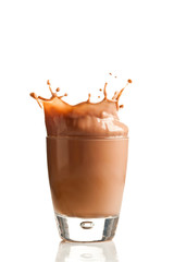 Chocolate splashing into glass