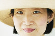 Close up portrait of woman in straw hat