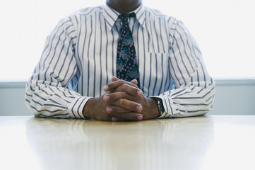 Midsection of businessman at desk