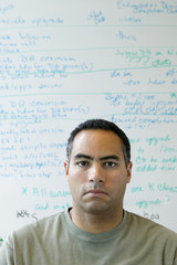 Portrait of man in front of white board