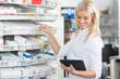 Female Chemist Standing in Pharmacy Drugstore