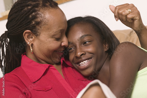 Close up of mother and teenage daughter hugging