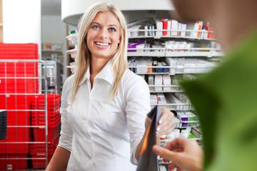 Female Pharmacist With A Customer In Pharmacy