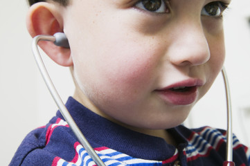 Close up of young boy with stethoscope