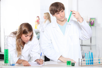 portrait of two students in a lab