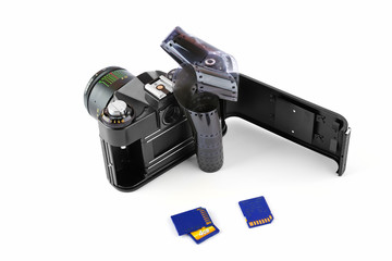 Classic manual camera with film and memory cards