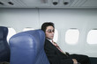 Portrait of businessman on airplane