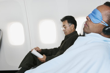 Two men on airplane