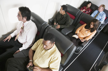 High angle view of passengers on airplane