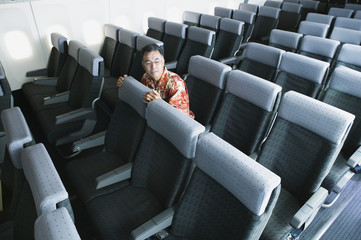 Man sitting in airplane