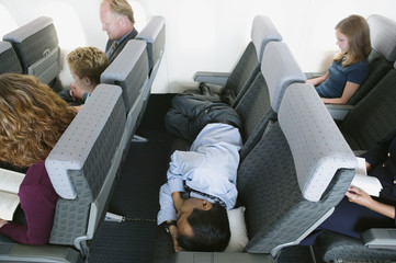 Businessman sleeping on airplane