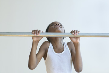 Boy doing chin-ups