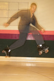 Man jumping with roller skates on