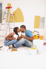 Couple kissing and eating chinese food while painting
