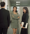 Businesswomen admiring colleague in office space
