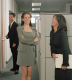 Businesswomen talking in office space