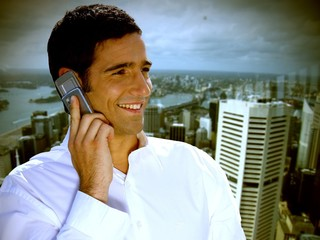 businessman making a call against urban background