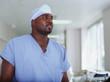 Male surgeon in hospital hallway