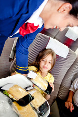 Flight attendant serving food