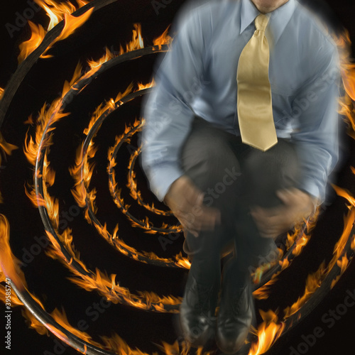 Man jumping out of focus with fire spiral background