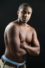 Young bare chested man posing