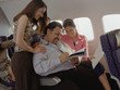 Mature man getting female attention on airplane