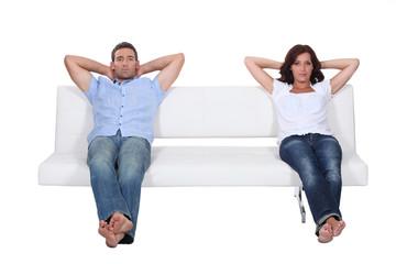 Couple sitting on white sofa