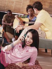 Young woman relaxing and using cell phone