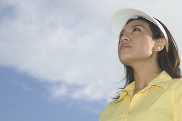 Woman with sun visor on