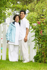 Portrait of a couple standing together on a lawn