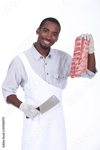 Happy butcher showing meat