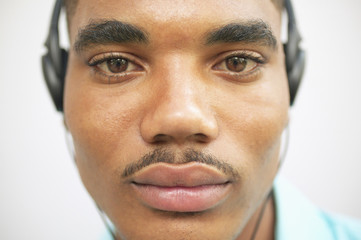 Close up portrait of man wearing headset