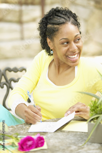 Woman writing on card