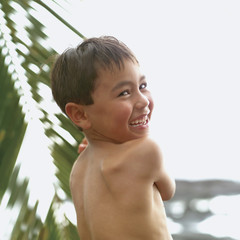 Rear view portrait of boy laughing