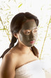 Woman with mud mask on face