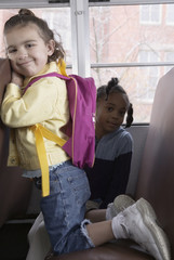 Portrait of girls on school bus