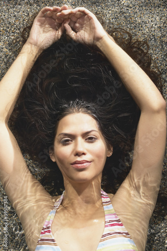 Portrait of woman floating in water