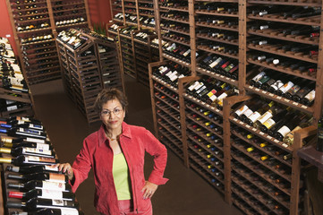 Portrait of woman in wine cellar