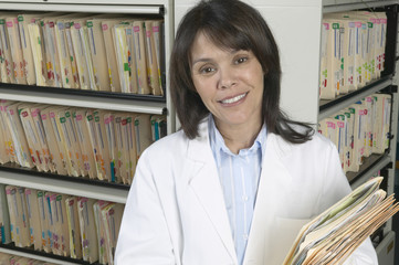 Portrait of doctor with files