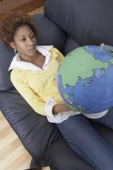 Woman holding globe armchair