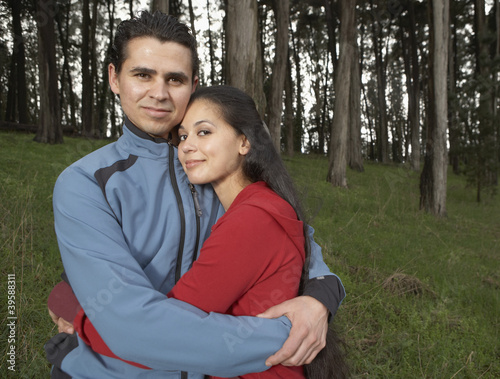 Portrait of couple hugging in forest