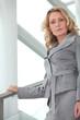 Businesswoman walking down steps